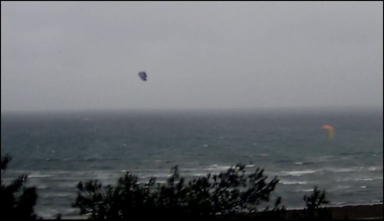 3 two-more-they-join-to-the-first-kite-in-bad-weather