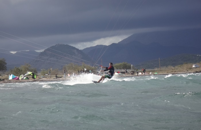 5 a kitesurfer riding towards Sa Marina - Pollensa